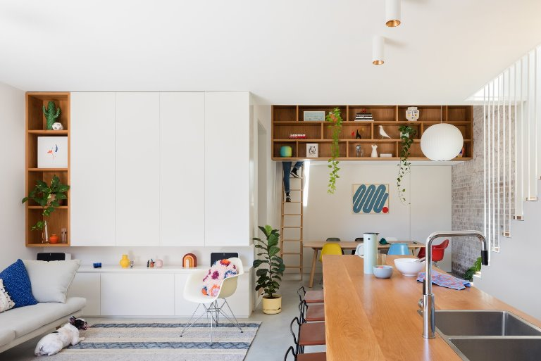 what-was-once-a-poorly-planned-floor-plan-has-transformed-into-open-brightly-lit-living-spaces-at-the-hub-of-the-home